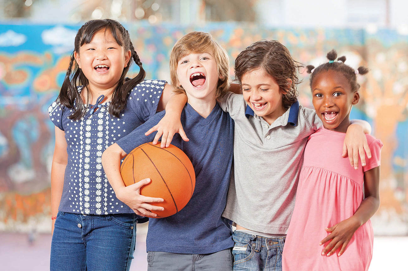 Group of happy children and basketball